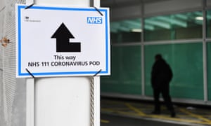 A sign provides directions to a  'Coronavirus Pod' at a hospital in London, Britain