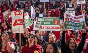 Educators, parents, students, and supporters of the Los Angeles teachers strike wave and cheer in Grand Park on 22 January in downtown Los Angeles,