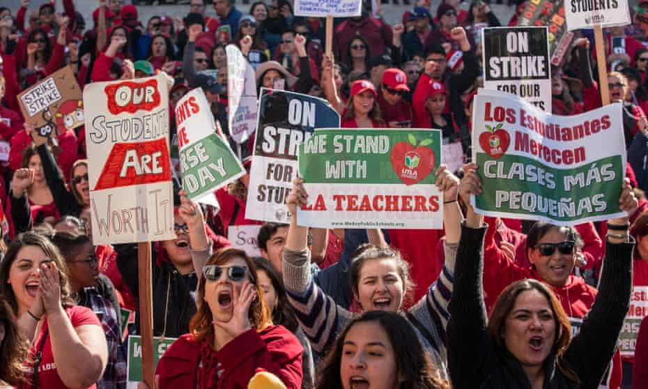 Educators, parents, students, and supporters of the Los Angeles teachers strike cheer in Grand Park on 22 January.