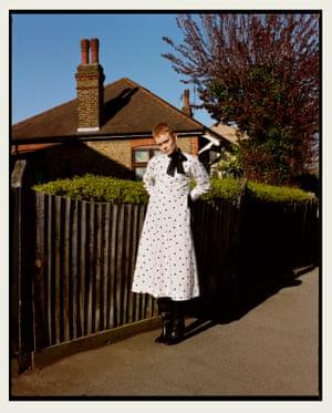White polka dot dress, £245, ganni.com. Black pussybow tuxedo shirt worn underneath, £460, paulsmith.com. Asymmetric earrings, £170, farisfaris.com. Black boots, £250, arket.com