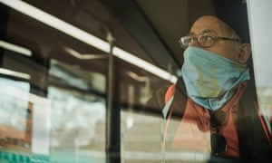 A Sioux Area Metro bus driver wears a protective mask while working in Sioux Falls, South Dakota on 15 April 2020.