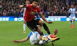Huddersfield Town's Christopher Schindler tackles Jesse Lingard on Saturday.