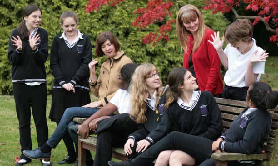 Limpsfield Grange schoolgirls with their headteacher Sarah Wild (in red) and Vicky Martin, their creative writing teacher.