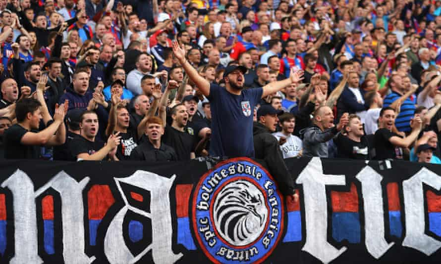 Crystal Palace's Holmesdale Fanatics, leading the vocal charge during a recent game at Selhurst Park.