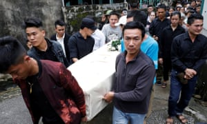 Relatives carry the coffin of John Hoang Van Tiep, who was among the dead found in the back of a lorry after being smuggled into Britain.