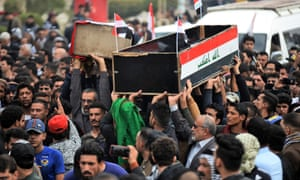 People carry the coffins of anti-government demonstrators killed during protests on Thursday in the central holy shrine city of Najaf, Iraq.
