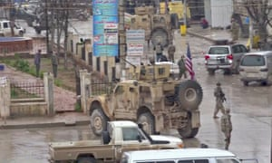 An image grab taken from a video obtained by AFPTV on Wednesday shows US troops gathered at the scene of a suicide attack in the northern Syrian town of Manbij.
