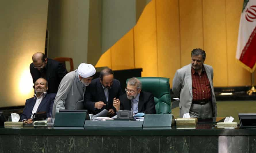 Iran's parliament speaker, Ali Larijani, second right, speaks with members of parliament during a session in Tehran on Sunday.