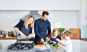 man, women and children cooking