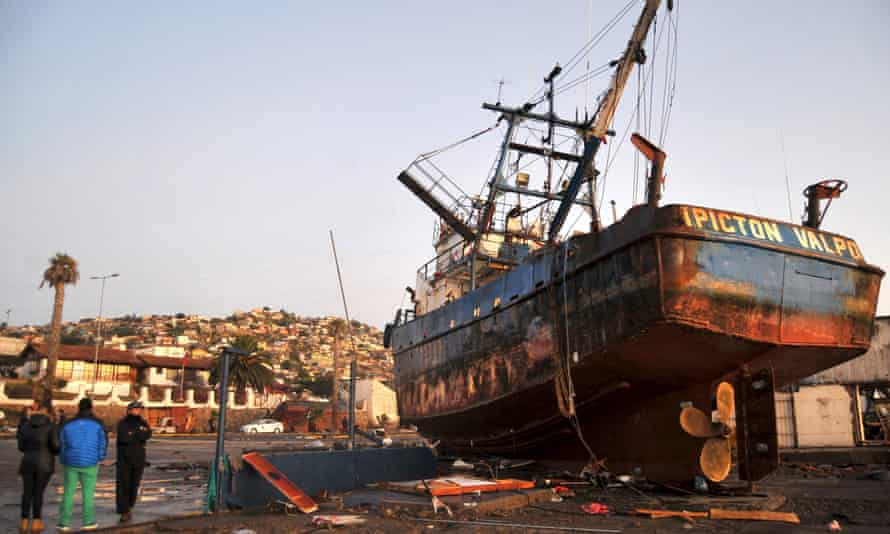 People look at a ship in the street in Coquimbo on Thursday.