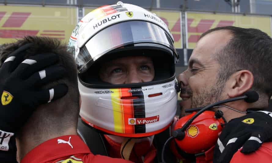 Ferrari driver Sebastian Vettel celebrates after clocking the fastest time in qualifying