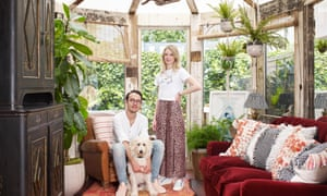 Charlie and Justin Salisbury in their refitted conservatory with their dog, Bob.
