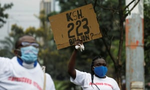 A protester holds a placard during a demonstration against suspected corruption.
