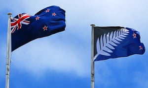 The current New Zealand flag, and the blue-and-black preferred alternative fly from a building in New Lynn, Auckland.