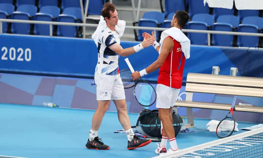Andy Murray shakes hands with Novak Djokovic after a practice match in Tokyo.