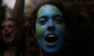 Demonstrators take part in a march as part of a world-wide protest called by the Fridays for Future movement against climate change in Madrid, Spain