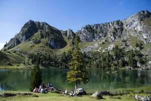 People enjoy the beautiful weather at Seeberg Lake at Diemtigtal in the Bern canton