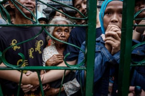 Yogyakarta, Indonesia: People queue outside the gate of a mosque