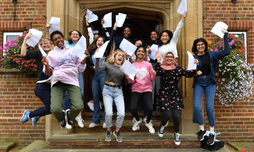 Pupils celebrate with their GCSE results at King Edward VI high school for girls, in Birmingham.