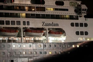 The cruise ship MS Zaandam, which is gripped by a deadly coronavirus outbreak, pictured on Sunday as it navigated the Pacific side of the Panama Canal