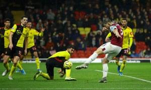 Burnley's James Tarkowski thumps home the visitors' third goal.
