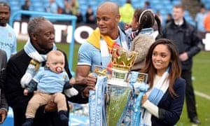 Two's Kompany: Pierre Kompany with his son Vincent with the Premier League trophy in May 2014