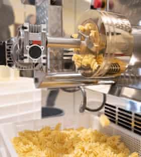 The noodle machine makes fresh pasta.