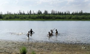 Children play in the Krugloe lake outside Verkhoyansk