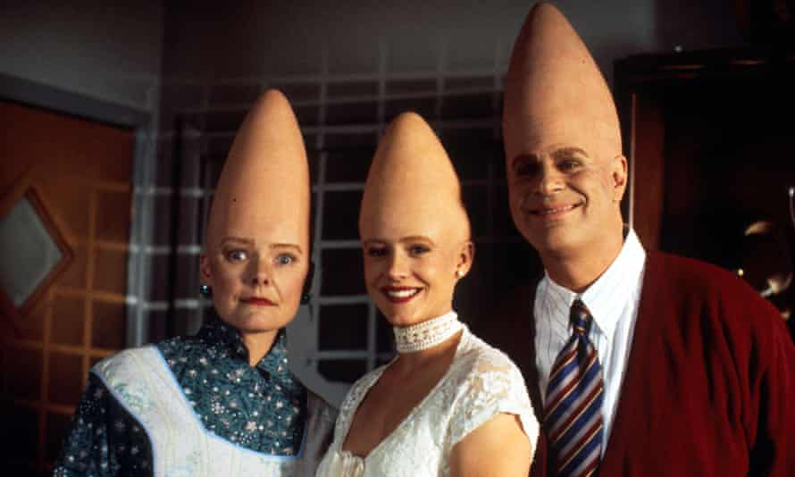 Jane Curtin, Michelle Burke and Dan Aykroyd in Coneheads, a movie maintains its lightness through the delight of its language.