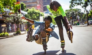 Nelson Mbusyei and Angela Martha practise a move known as the footgun on a downtown street.