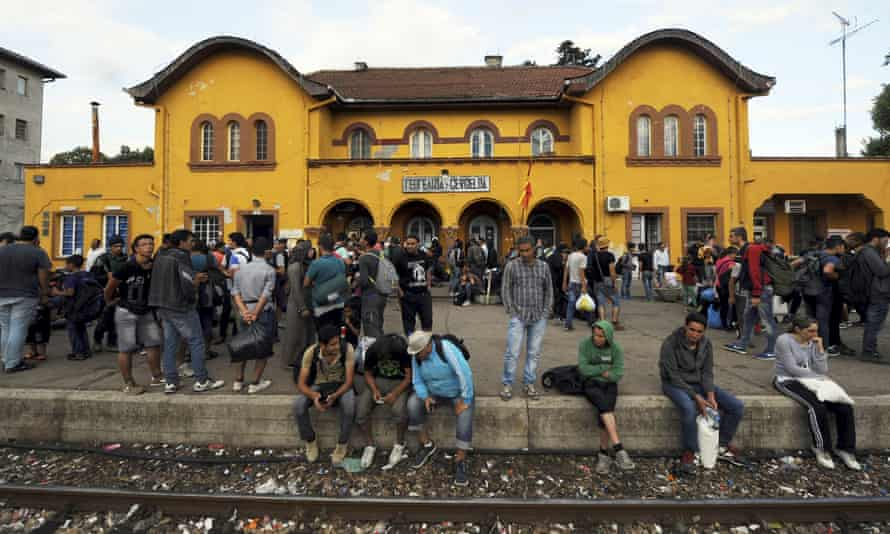 A group of migrants who have made it through police blockades arrive at Gevgelija's railway station.