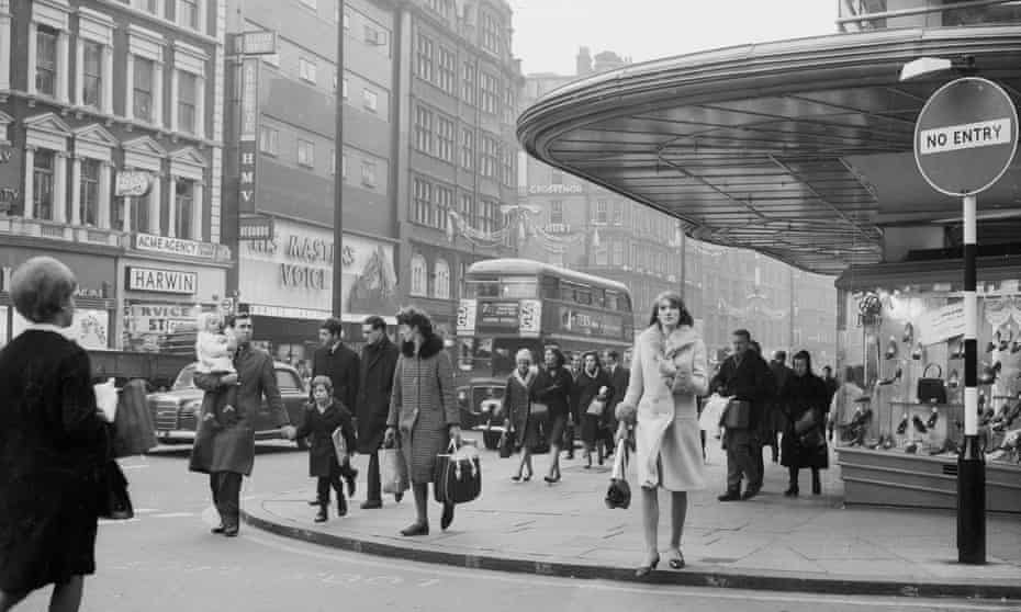 Last-minute Christmas shoppers in Oxford Street in 1964