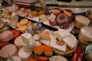 Cheese stall at Marche Couvert Beauvau, Paris
