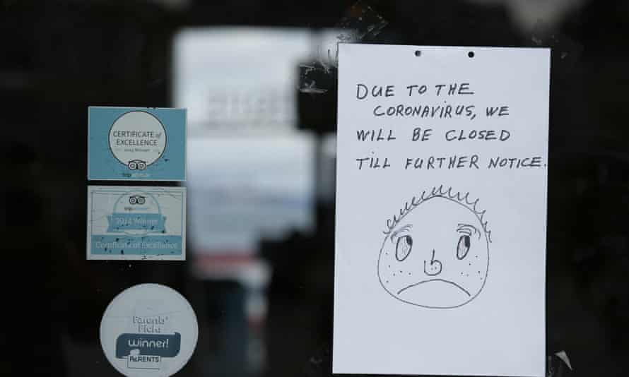 A closed sign is posted to the entrance of the Musée Mécanique penny arcade at Fisherman's Wharf, 16 March 2020, in San Francisco.