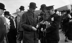 A Tote official paying out in the paddock at Cheltenham from a portable machine in 1938.