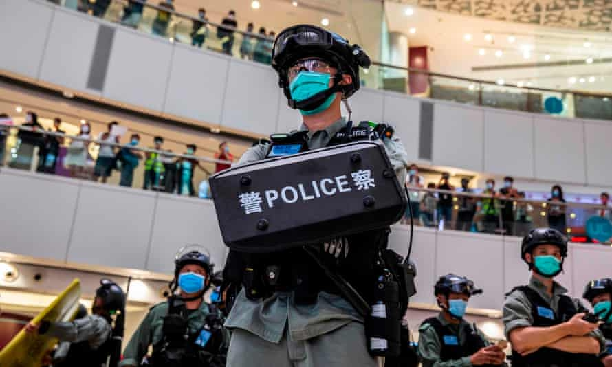 A riot police officer stands guard during a clearance operation at a demonstration in a mall in Hong Kong