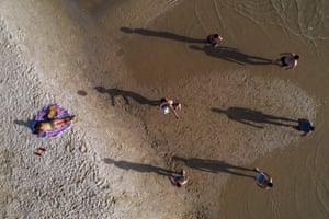 People enjoy the beach front in Tel Aviv, Israel, Wednesday, May 20, 2020.