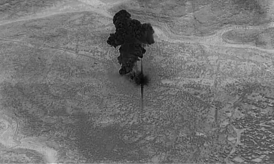 A screengrab from a handout military drone video shows a smoke cloud from the compound of the Islamic State leader Abu Bakr al-Baghdadi in Syria after a US forces raid on 26 October 2019.