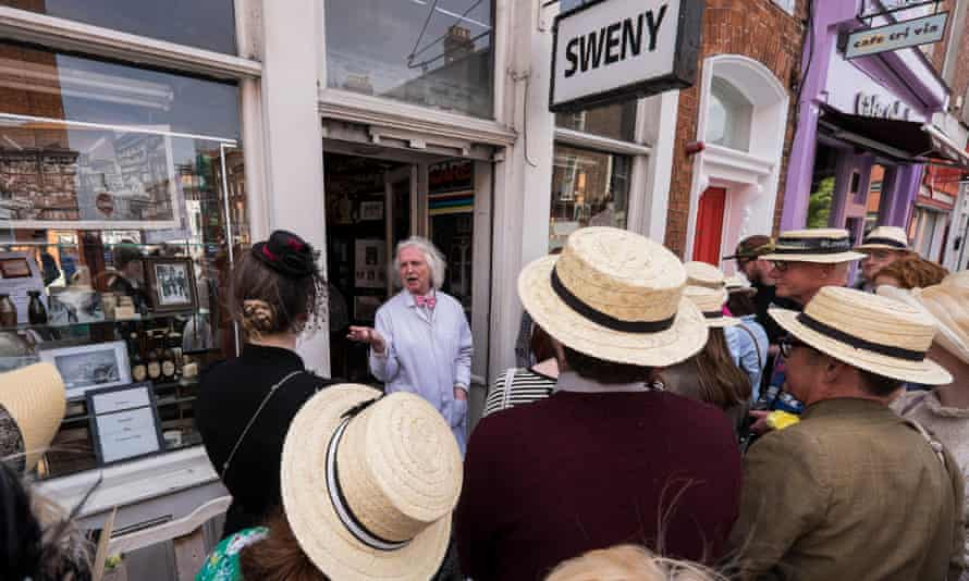 Guide PJ Murphy with a tour group celebrating Bloomsday outside Swenys Pharmacy.