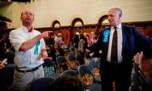A Green party candidate argues with a Brexit party candidate after the announcement of the results for South East England at Southampton civic centre