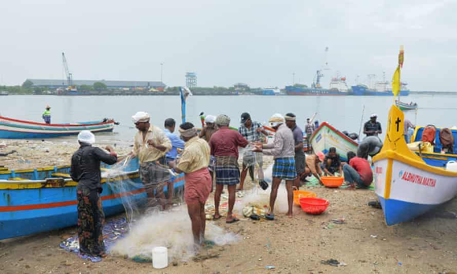 Indian fishermen sort their catch at Kollam beach in Kerala. Since 2017, about 80 tonnes of plastic has been collected from the sea there.