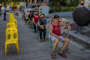 Quezon city, Philippines. Residents queue before undergoing rapid antibody testing for covid-19 after they are allowed back to work