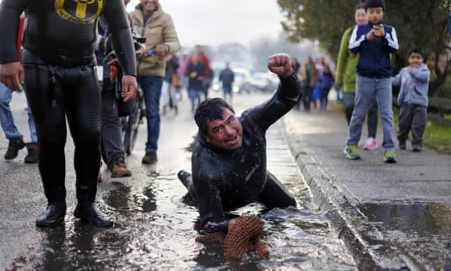 A Chilean shellfish diver reacts during a protest against a ban on fishing due to the red tide phenomenon, on Chiloe Island, southern Chile.