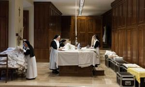 Nuns at work ironing.