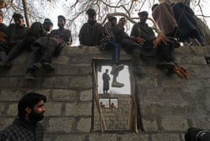 People attend the funeral of Noor Mohammad Tantray in Kashmir