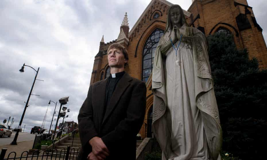 Father Michael Stumpf stands outside of St Mary of the Mount Church.