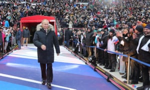 Vladimir Putin arrives for his pre-election campaign rally at Luzhniki Stadium in Moscow
