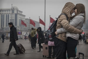 A couple at Beijing Railway Station