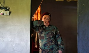 A female Peshmerga fighternear the frontline of the fight against Isis in Nawaran near Mosul