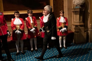 Lady Usher of the Black Rod, Sarah Clarke, walks past page boys for the state opening of parliament.